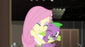 Fluttershy hugs and nuzzles Spike the dog EGS2.png