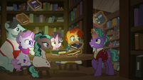 Firelight levitating a large amount of books S8E8
