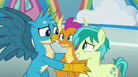 Gallus looks embarrassed at Smolder and Sandbar S8E2