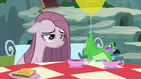 Pinkie depressed at the tea party table S8E18