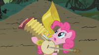 Pinkie gesturing to her instruments S1E10