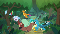 Ponies and students running through woods S8E9