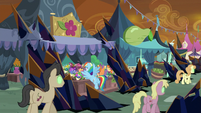 Rainbow Dash in front of a flower stand S9E2