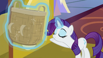 Rarity offering the big basket to Spike S9E19