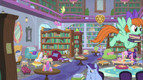 School of Friendship students in the library S8E11