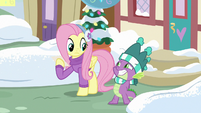Spike grinning innocently at Fluttershy MLPBGE