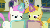 Twinkleshine and unicorn mare look at Tasty Treat flyer S6E12
