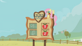 Fluttershy with a rose in her mouth S01E13.png