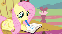 Fluttershy writing on the journal S4E14