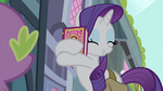 Rarity hugging the book S4E23
