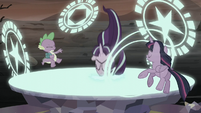 Twilight, Spike, and Starlight being pulled into the portal S5E26