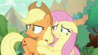 Applejack and Fluttershy looking around S8E23
