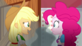 Applejack looking embarrassed at Pinkie Pie SS14.png