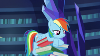 Rainbow Dash on a tall stack of books S7E25