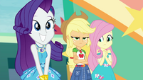 Rarity grinning wide; Applejack still peeved EGROF