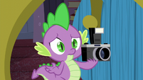 Spike holds the camera S5E12