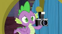 Spike holds the camera S5E12