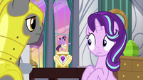 Starlight looks innocently at music box Twilight S7E10