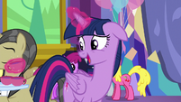 Twilight Sparkle picks up a cup of punch S7E1