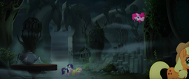 Pinkie pops up from behind another building MLPTM