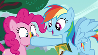 Rainbow stuffs another cookie in Pinkie's mouth S6E15