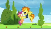 Spitfire holding up Scootaloo S8E20