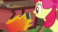 Apple Bloom paints flames on the cart S6E14