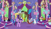 Discord holding Twilight Sparkle's wings S7E1