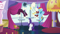 Rainbow explains why she's in Canterlot; Rarity continues adjusting hat S5E15.png