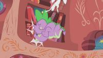 Spike slams into the bookshelf S1E07