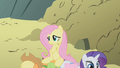 Fluttershy sitting on Applejack and Rarity S1E07.png