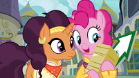 Pinkie holding flyers and arrow sign S6E12
