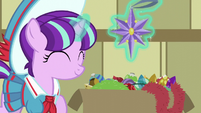 Young Snowfall levitating a star ornament S6E8