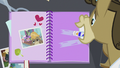 Matilda putting glue on the page of the scrapbook S5E9.png