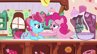Pinkie Pie cheering up Mrs. Cake S9E13