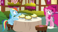 Rainbow Dash points behind Pinkie Pie again S7E23