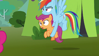 Rainbow carries Scootaloo to the bleachers S8E20