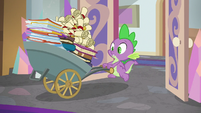 Spike enters with wheelbarrow of binders and scrolls S8E15