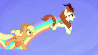 AJ gallops alongside Autumn Blaze S8E23