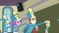 Band members with their arms outstretched EG3.png