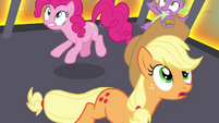 Pinkie, Applejack and Spike sees their cage being levitated S4E26