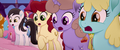 Ponies looking at big mess of cake MLPTM.png