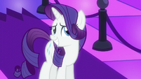 Rarity smiling at the bouncer S6E9