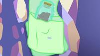 Starlight places anger bottle in her saddlebag S7E2