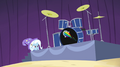 Trixie hiding behind drum platform EG2.png