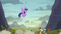 Twilight looking down at the fighting S5E23