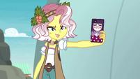 Vignette aims her phone at Rainbow EGROF