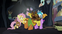 Fluttershy shoves Twilight and Cattail toward the door S7E20