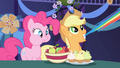Pinkie Pie eating and Applejack pulling Rainbow's tail S1E1.png