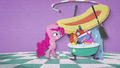 Pinkie puts a rubber raft on the pile of toys BFHHS2.png